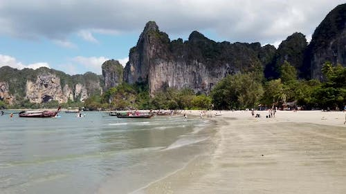 People relaxing on the beach of Railay Beach in AO Nang in Thailand