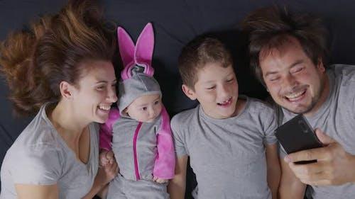 Portrait of Happy Family Taking Selfie