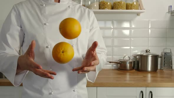 Thumbnail for Chief-Cooker Juggles An Oranges In A Kitchen