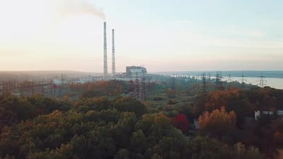 view of the territory of the power plant with power lines on the background of the river