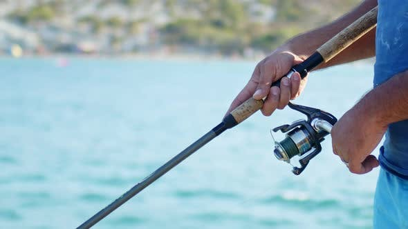 Catching Fish With Fishing Rod