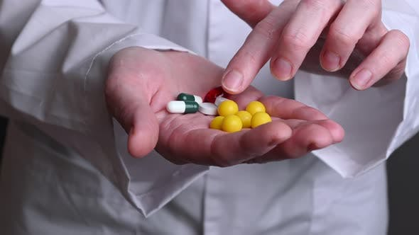 Thumbnail for A Female Doctor Hold in Hands Tablets and Vitamins. Treatment of Sick People