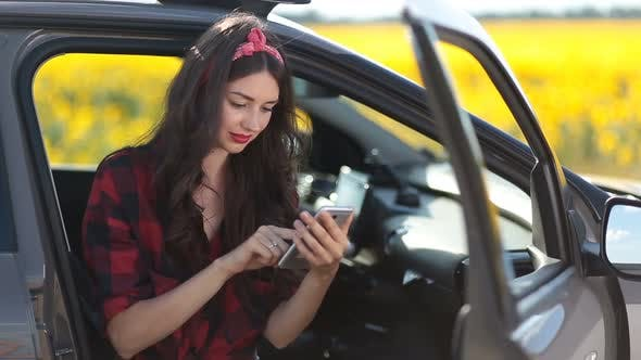 Thumbnail for Cute Girl Browsing the Net with Smartphone in Car