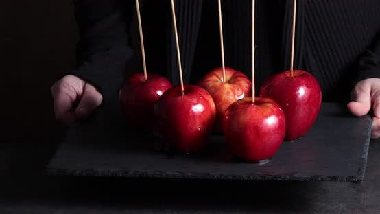 Thumbnail for Woman holding plate with candy apples