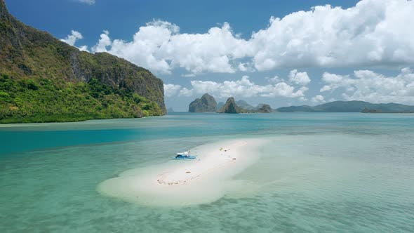 Thumbnail for Aerial Drone - Tourist Banca Boat Moored at Sandbar During Low Tide. Beautiful Lagen Island