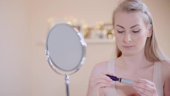 Thumbnail for Woman Doing Makeup Painting Eyelashes with Mascara