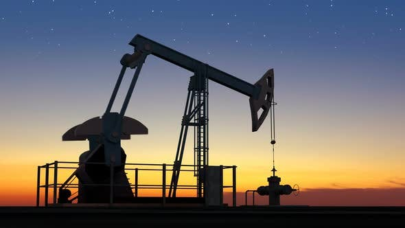 Oil Pump Jack Extracting Crude Oil Under Starry Sunset Sky