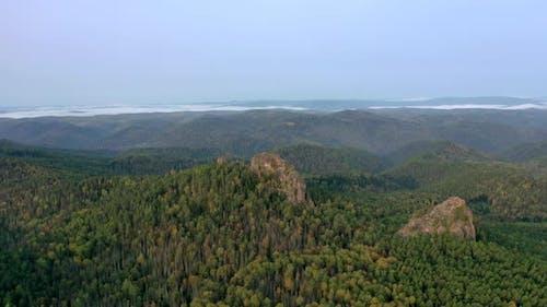 Aerial Hyperlapse of Rock Peaks in the Forest at Dawn. Stolby National Park, Krasnoyarsk, Russia.