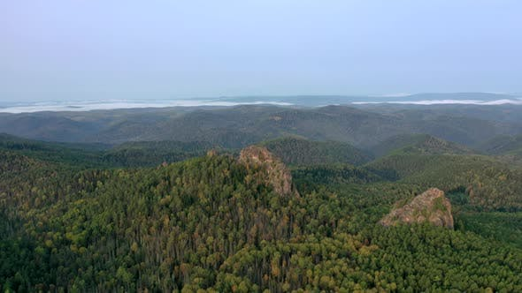 Aerial Hyperlapse of Rock Peaks in the Forest at Dawn. Stolby National Park, Krasnoyarsk, Russia.