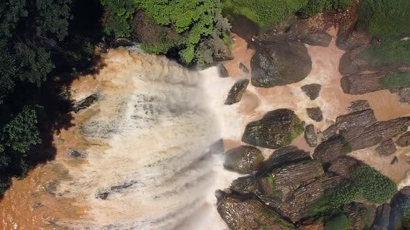 Thumbnail for Drone View of Waterfall with Dirty Water in the Rainforest.