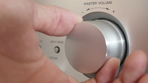 Thumbnail for Setting volume up on silver modern audio amplifier jog dial 4K 2160p UltraHD footage - Higher volume