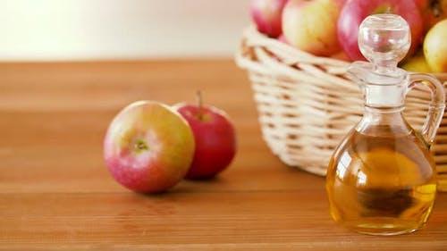 Apples in Basket and Jug of Juice or Vinegar