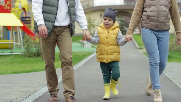 Thumbnail for Happy Child Walking to Playground with Parents