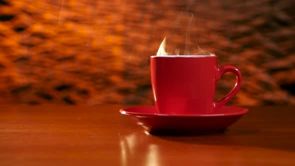 Thumbnail for Cup of Coffee Is on the Table on a Red Saucer