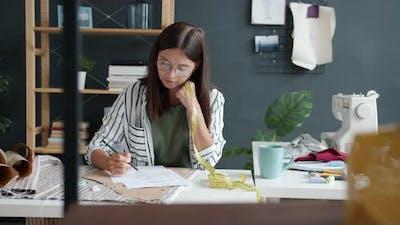Portrait of Creative Girl Fashion Designer Sketching Garment Working in Studio Alone