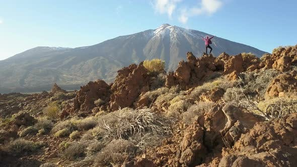 Thumbnail for Young Woman Arms Outstretched Observes a Huge Crater of Teide Volcano, Tenerife, Canary Islands
