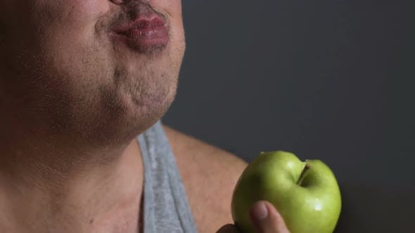 Thumbnail for Fat Male Chewing Green Apple, Dieting and Calories Counting, Healthy Lifestyle