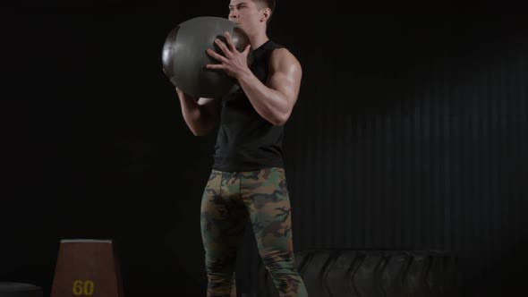 Thumbnail for Man Doing Squats with Heavy Ball