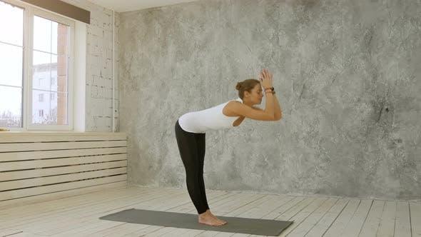 Thumbnail for Beautiful Sporty Fit Woman Practices Yoga Asana Sun Salutation Pose