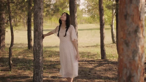 Thumbnail for Happy Woman in Forest Enjoying Nature. Cute Young Girl Walking Outdoors