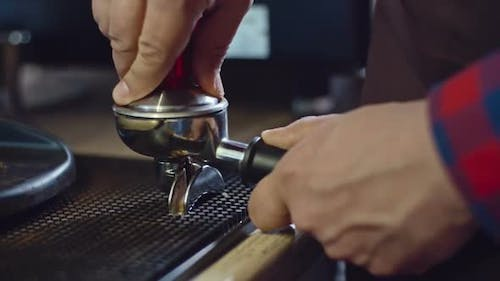 Pressing Coffee with Tamper