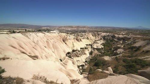 Limestone Hoodoos and Sedimentary Fairy Chimneys in an Arid Drainage Basin Valley, Cappadocia Turkey