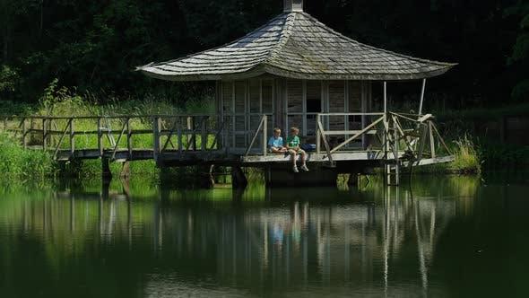 Boys fishing off dock