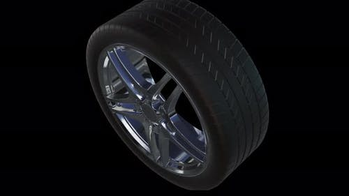 4K Loop Animation of Car Wheel on black background