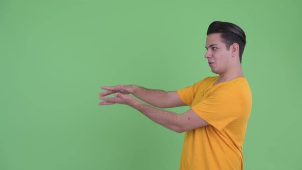 Thumbnail for Happy Young Multi Ethnic Man Snapping Fingers and Showing Something
