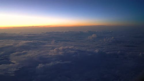 Sunset from airplane passenger window lookout.