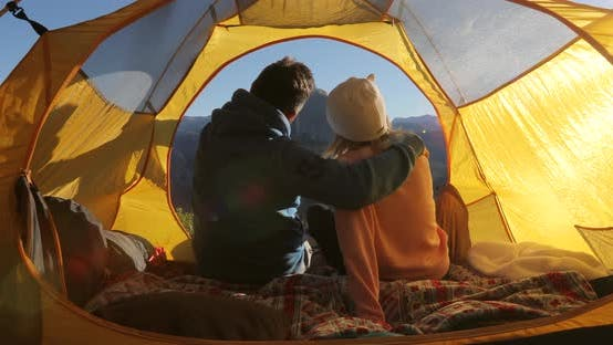 Thumbnail for Camping at Yosemite National Park. Sierra Nevada Ridge. A Couple Takes a Selfie Sitting in a Tent.