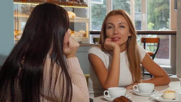 Thumbnail for Attractive Woman Talking To Her Best Friend at the Coffee Shop