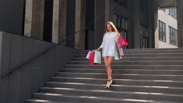 Thumbnail for Attractive Girl Walking From Centre Mall with Shopping Bags, Happy with Purchase on Black Friday