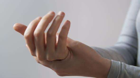 Close Up of Woman Spraying Hand Sanitizer