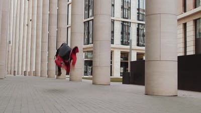 Man Practicing Parkour Stunts Outdoors in the City