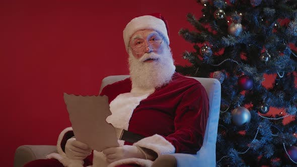 Thumbnail for Santa Claus Reading Wish Letter on Christmas Eve