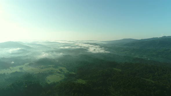 Thumbnail for Flyover a Green Valley Sunrise