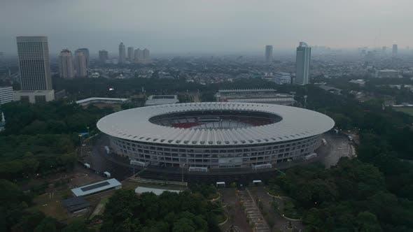 Close Up Tilting Aerial Shot of Gelora Bung Karno Athletic Stadium Facilities in Modern City Center