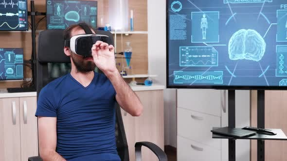 Thumbnail for Male Scientist Sitting on a Chair and Using Virtual Reality Goggles