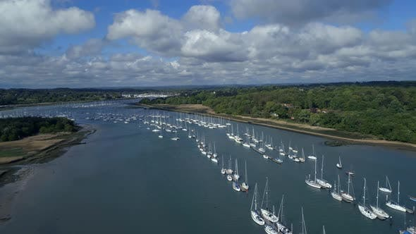 Thumbnail for Aerial View of Yachts Moored in an Estuary at Sunset