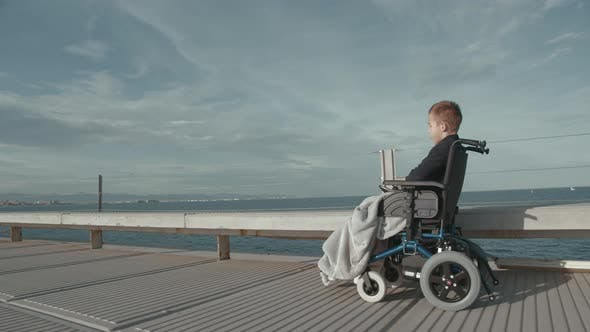 Thumbnail for Disabled Boy in Electric Wheelchair Outside