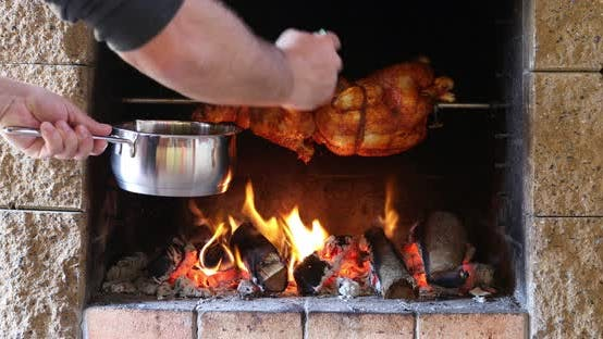 Thumbnail for chicken roasting on a spit