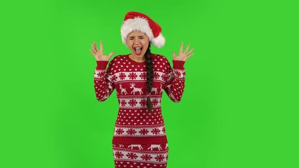 Thumbnail for Sweety Girl in Santa Claus Hat Is Screaming. Green Screen