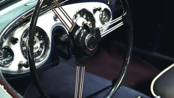 Close-up of Black-metal Steering Wheel of Vintage Vehicle