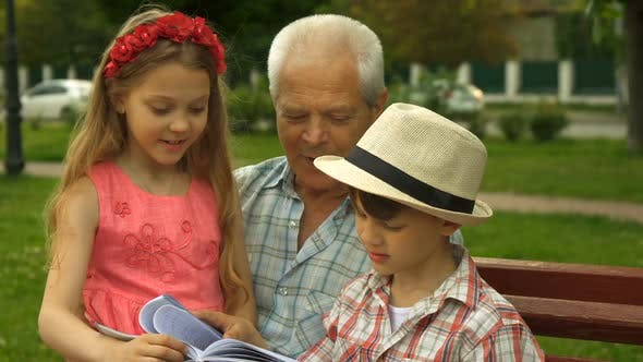 Thumbnail for Children Spend Time with Their Granpa Outdoors