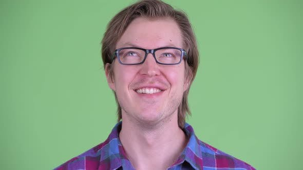 Thumbnail for Face of Happy Young Handsome Hipster Man Thinking and Looking Up