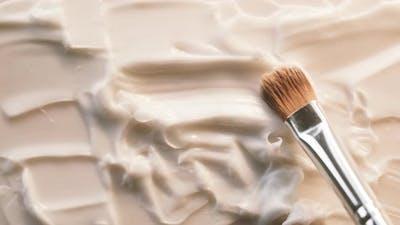 Smearing Cream on White Background Using Brush