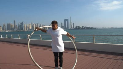 Dubai Marina in the Background of the Wheel Gymnastics Performance