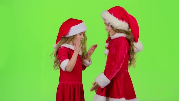 Thumbnail for Children in Red Suits Play New Year's Games, Smile and Have Fun. Green Screen