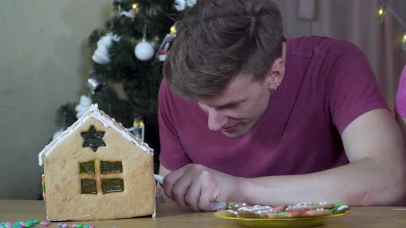 Thumbnail for A Guy Decorates a Christmas Gingerbread House